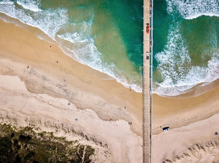 Beach Land Sand Day Water Nature Outdoors High Angle View No People Sea Sport Wet Built Structure Sunlight Pattern Motion Architecture Wall - Building Feature