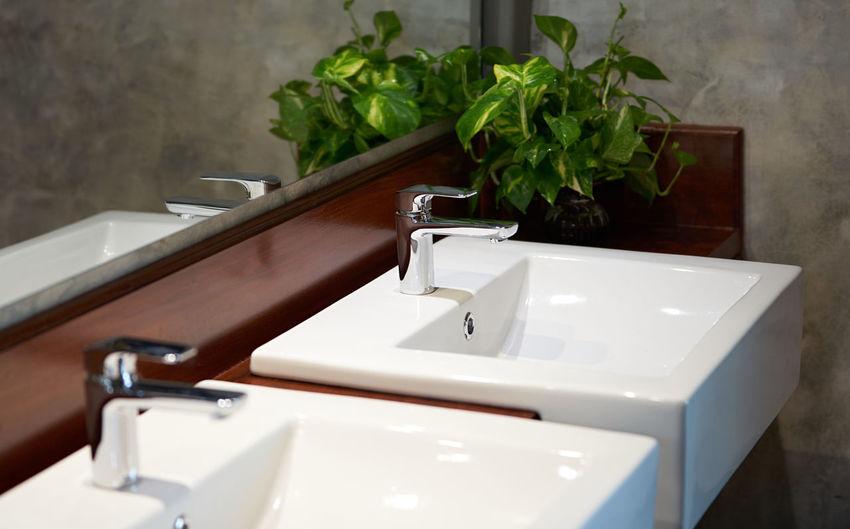 Close-up of water tap plumbing at basin