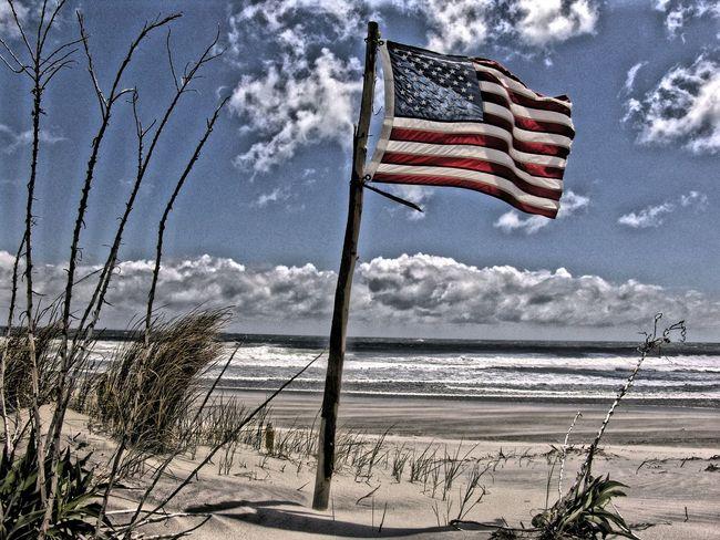 Flag on the shore USA FLAG Shore Beach Beach Photography Wind Flag Portrait Of America Ocean View On The Beach USA