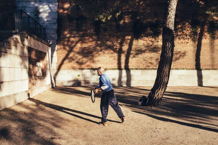 Single Tennis Sports Tennis Ball Shadow One Person Full Length Sunlight Lifestyles Men Outdoors