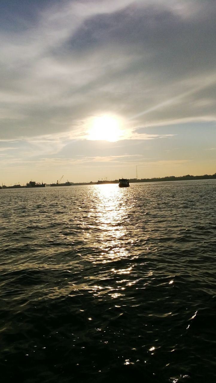sunset, sea, sky, water, nature, scenics, beauty in nature, tranquility, tranquil scene, no people, silhouette, cloud - sky, reflection, outdoors, rippled, waterfront, sunlight, nautical vessel, sailing, day