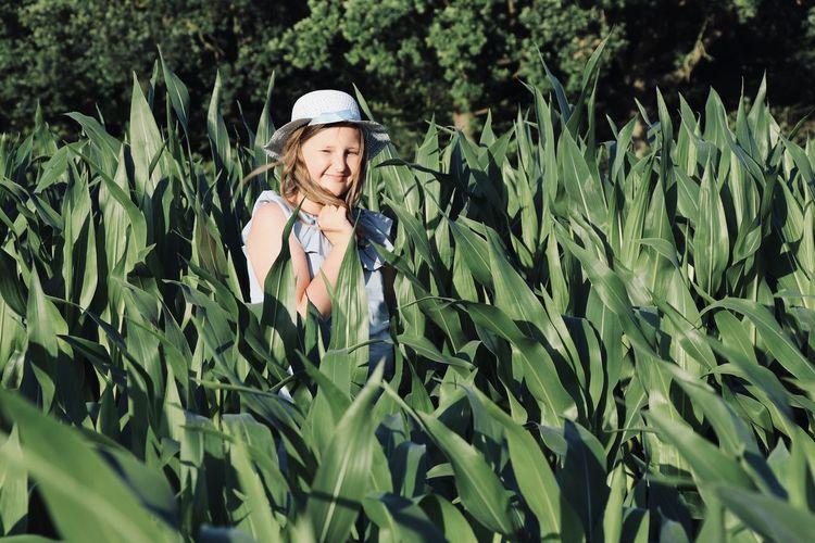 Portrait of girl wearing hat on field