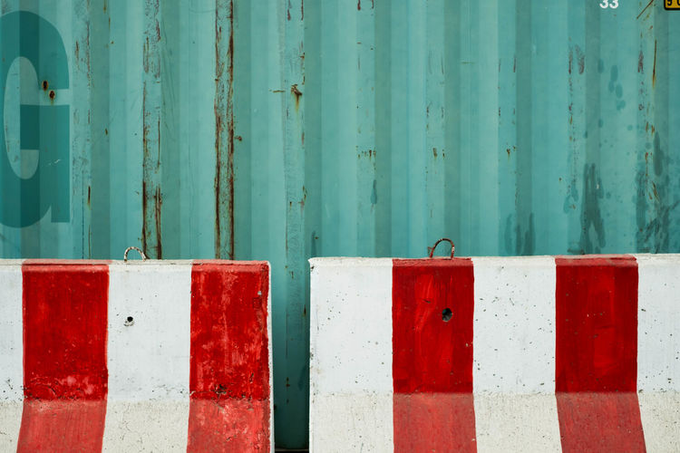 Green Containers And the concrete barrier. Container Green Barrier Close-up Concrete Day Green Color Metal No People Outdoors Red Rusty Steel Textured  Wood - Material