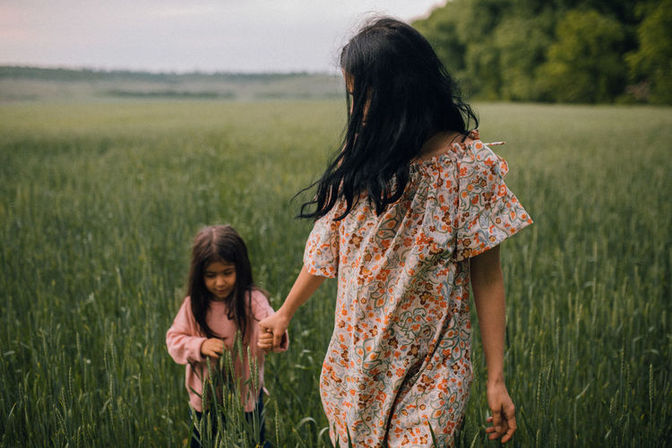 Mother and daughter on field