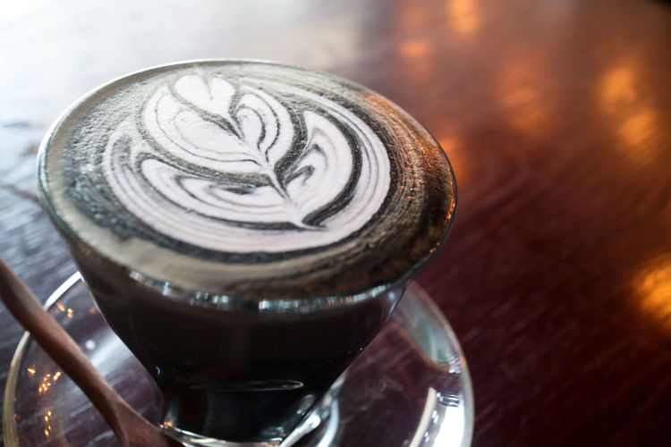 Charcoal Latte with Beautiful Latte Art Latte Black Cafe Menu Cappuccino Charcoal Close-up Coffee Coffee - Drink Coffee Cup Coffee Menu Drink Food And Drink Freshness Froth Art Frothy Drink Indoors  Latte Latte Art Latte Art Heart Milk No People Still Life Table Trendy Trendy Lifestyle