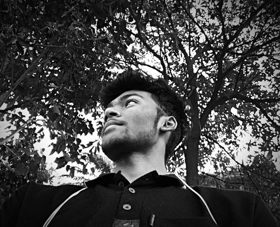 Enjoying Low Angle View One Person Only Men Headshot Tree One Man Only Outdoors Real People Young Adult Day Adults Only People Adult Blackandwhite Blackandwhite Photography Selfie ✌ Portrait Black And White Black & White