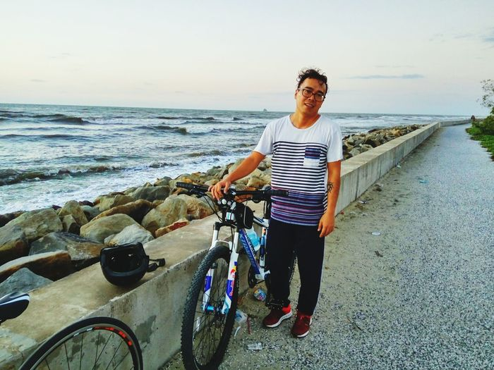 tired look after a long tripEyeEm Selects Two PeopleBicycle Beach Cycling Sea Mid Adult Full Length Adult People Adults Only Vacations Casual Clothing Transportation Travel Outdoors Day Summer Horizon Over Water Young Adult Happiness