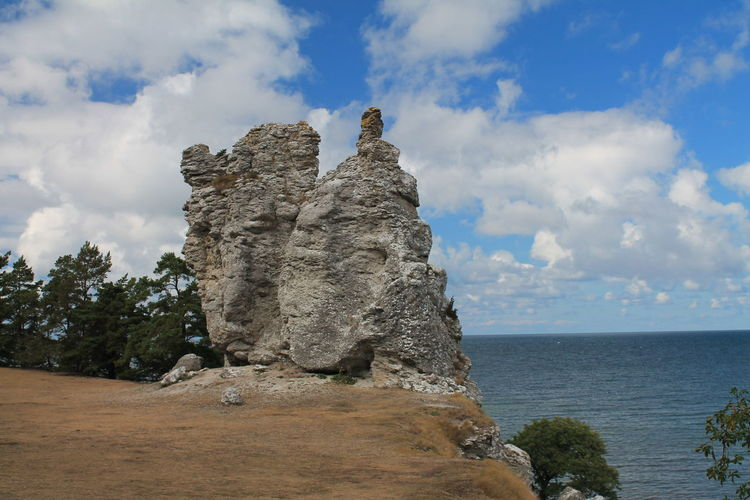 Beauty In Nature Blue Cloud Cloud - Sky Cloudy Day Gotland, Sweden Green Color Growth Horizon Over Water Idyllic Klintehamn Nature No People Non-urban Scene Outdoors Plant Remote Rock Formation Scenics Sea Sky Tranquil Scene Tranquility Tree