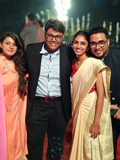 family Young Women Eyeglasses  Smiling Standing Looking At Camera Happiness Well-dressed Sari Wedding Ceremony Arm In Arm Indian Culture  Ceremony Wedding