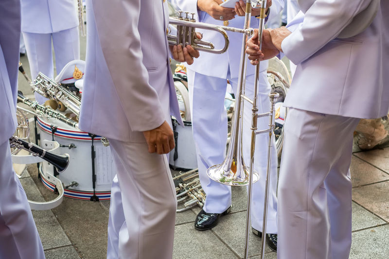 Standby Adult Celebration City Cooperation Coworker Day Group Of People Holding Low Section Marching Band Men Midsection Music Occupation Outdoors People Real People Responsibility Standing Teamwork Togetherness Trombone Trumpet Uniform Musical Equipment Marching