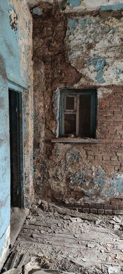 Window of old abandoned building