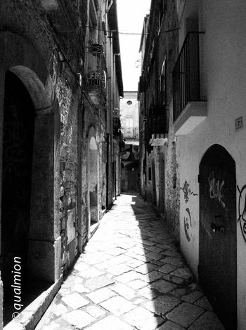 #urbanana: The Urban Playground Ancient City Cobblestone Streets Footpath Street View View Arch Black And White Building Exterior Cobblestone Footpath Narrow Old Old Buildings Old City Outdoors Paving Stone Perpective Stone Stone Material Street The Way Forward Town Urban