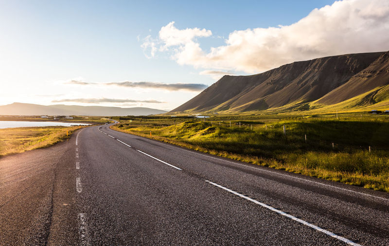 Empty road passing through landscape