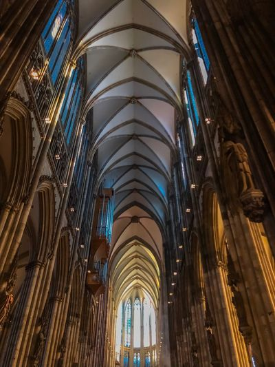 Kölner Dom Historical Monuments Historical Building Medieval Cathedral Dom Köln Built Structure Architecture Religion Belief Place Of Worship Spirituality Low Angle View Building Exterior Travel Destinations Travel Building Architectural Column No People Skyscraper Ceiling Gothic Style Arch Glass Architecture And Art