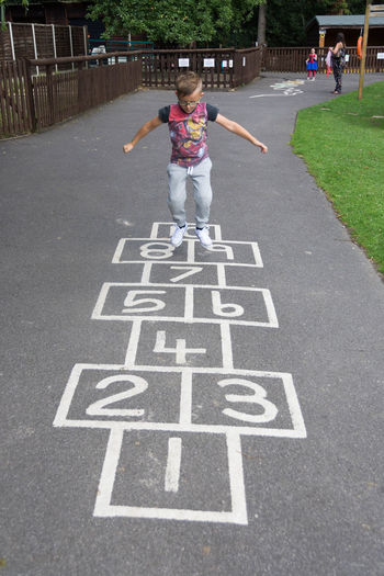 Boy Casual Clothing Check This Out Child Childhood Day Elementary Age Enjoying Life Eye4photography  EyeEm EyeEm Best Shots EyeEm Gallery Front View Full Length Hop Hopscotch Jump Jumping Leisure Activity Lifestyles Outdoor Games Park - Man Made Space Playground Playing Standing