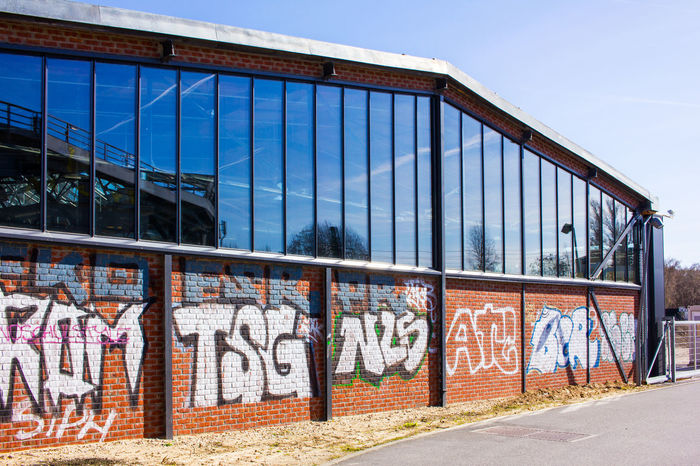 Architecture Art Art And Craft Berlin Building Exterior Built Structure Capital Letter Communication Creativity Day Gleisdreieck Graffiti No People Outdoors Park Am Gleisdreieck Sky Street Art Text Vandalism Wall Wall - Building Feature Western Script Window