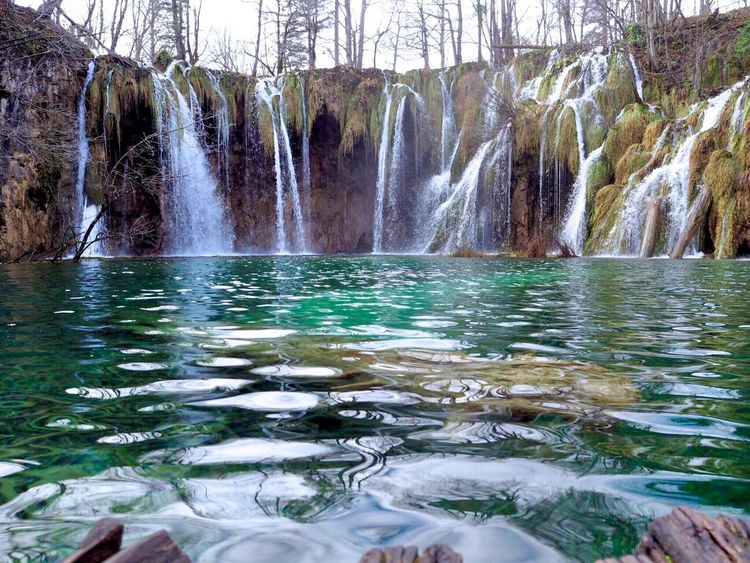 Travel Travel Destinations Nature Nature_collection Beauty In Nature Water Waterfront Reflection Waterfall Green Color Daytime Outdoors Beauty In Nature Enjoying Life Enjoying The View Capture The Moment Enjoying The Moment Atmospheric Mood Park Calm Relaxing EyeEm Best Shots EyeEmBestPics at Plitvice National Park in Croatia