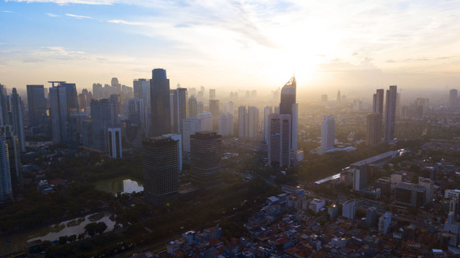 High angle view of buildings in city against sky during sunset