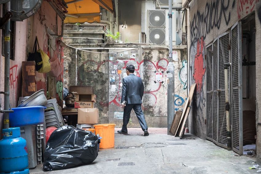 Hong Kong's intricate network of alleys. Travel China HongKong Storytelling Streetphotography Architecture Built Structure Graffiti City Full Length Real People Building Exterior People Lifestyles