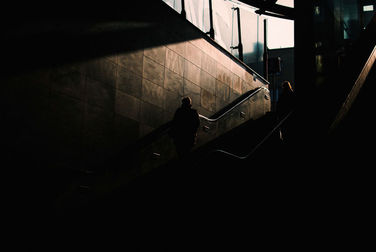 Persephone Descends Light And Shadow The Week on EyeEm Capture The Moment Nikonphotography Street Photography Cinematic Photography Architecture Real People Built Structure Staircase Railing One Person Walking Lifestyles Steps And Staircases High Angle View Indoors  Silhouette Standing Men Transportation Leisure Activity Nature Dark Autumn Mood Streetwise Photography