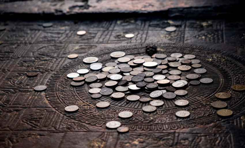 High angle view of coins on table