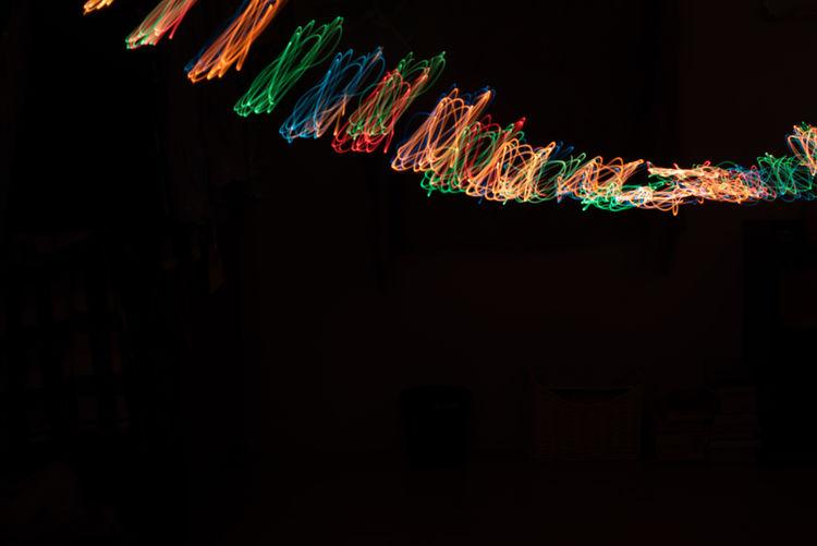 Smoke signal Multi Colored Illuminated No People Indoors  Night Glowing Dark Creativity Long Exposure Light Motion Light - Natural Phenomenon Copy Space Lighting Equipment Light Painting