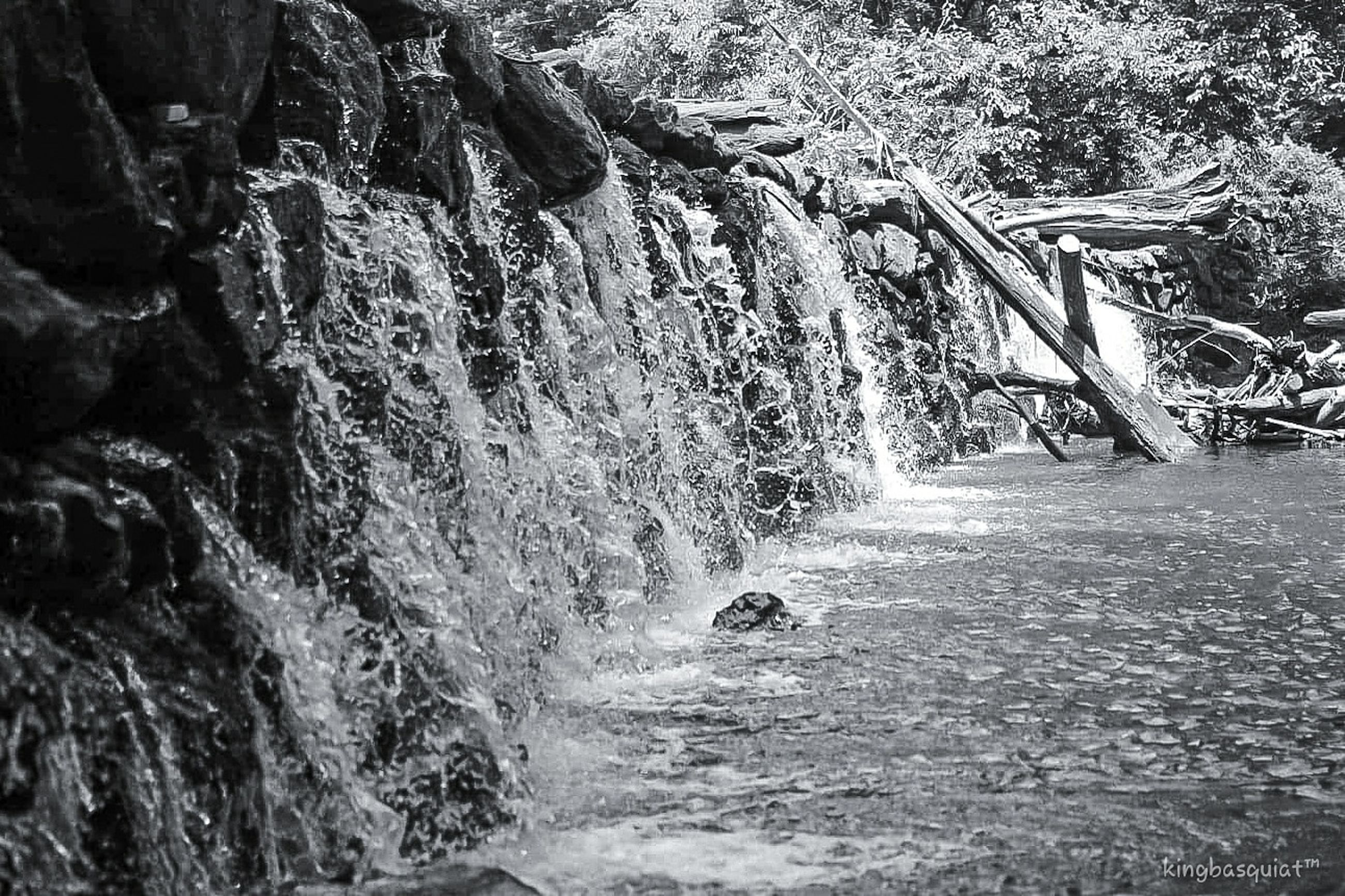 waterfall, water, black and white, nature, rock, monochrome photography, motion, day, tree, beauty in nature, monochrome, scenics - nature, land, no people, plant, river, flowing water, outdoors, stream, forest, waterfront, water feature, non-urban scene, rapid, rock formation, splashing, flowing, tranquility, long exposure