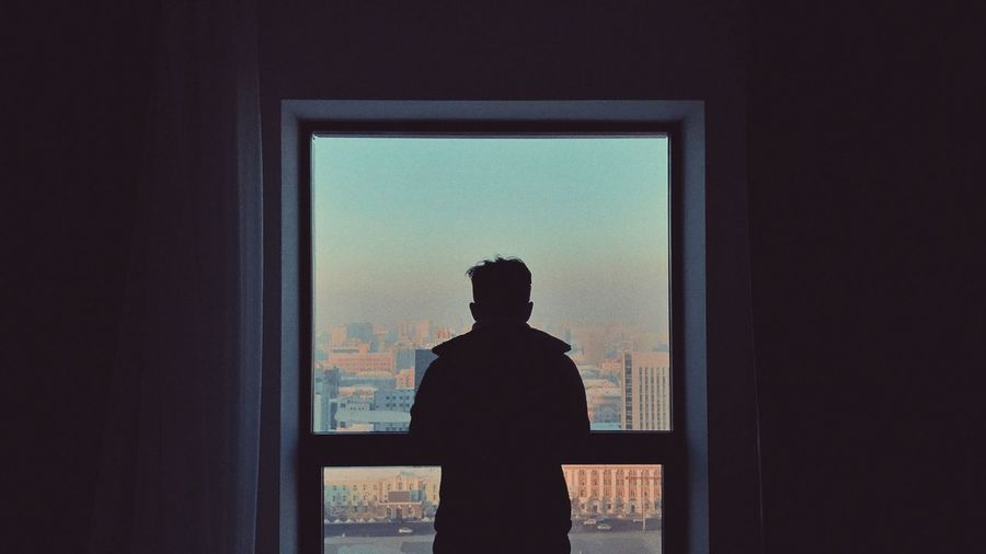 Traveling Home For The Holidays One Person Real People Waist Up Curtain Standing Window Indoors  Men Silhouette Drapes  Day Travel EyeEm Mongolia Lifestyles Light And Shadow Happy Cityscape Relaxation Photooftheday Vacations Landscape Beauty In Nature Modern