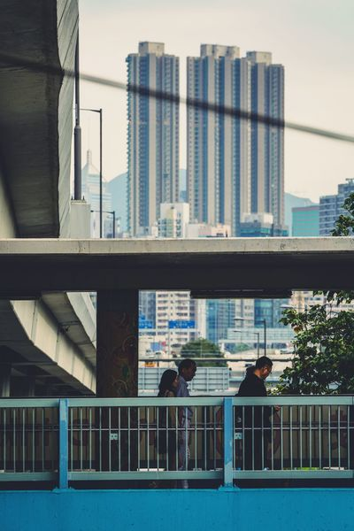 Street Photography Discoverhongkong Reframinghk Footbridge Built Structure Architecture Building Exterior City Building Railing Real People Modern Nature Men Transportation Connection Day Office Building Exterior Residential District Bridge Two People Office Outdoors People