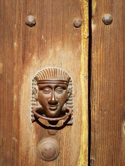 Knocker Door Knocker Egyptian Style Pharaonic Style Wood And Metal Rusty Metal Details Textures And Shapes Door Details Old Details Art And Craft Door Wood - Material Outdoors Day Close-up No People Full Frame Sculpture