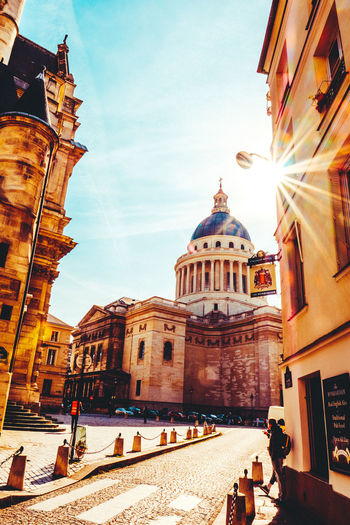 Architecture Baroque Style Building Exterior Built Structure City Clock Tower Day Dome History Large Group Of People No People No People Outdoors Outdoors Pantheon Paris People Place Of Worship Real People Religion Sky Spirituality Sunflare Sunlight Sunrays Travel Destinations