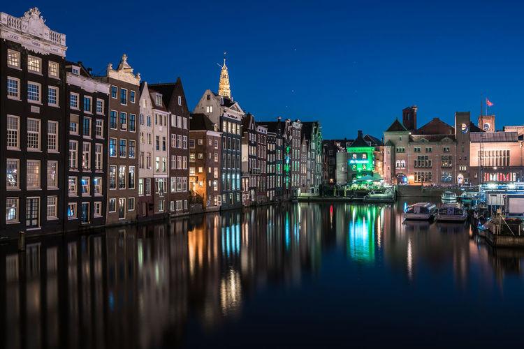 Illuminated buildings against sky