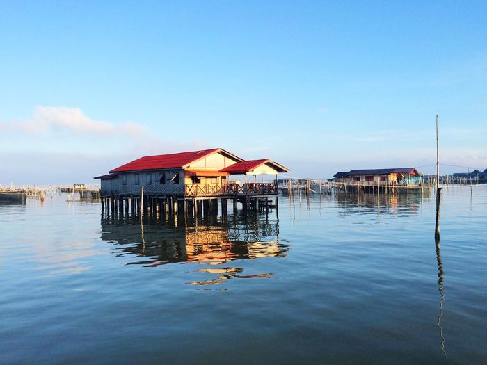Homestay in the lake House On Water Resort Tourist Destination Tourist Attraction  Homestay EyeEm Selects Water Sky Architecture Built Structure Waterfront Building Exterior Reflection House Nature Building Stilt House Blue Sea Day No People Tranquility Beauty In Nature Outdoors