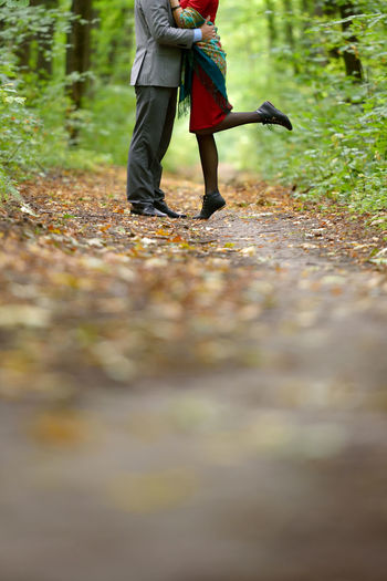 Autumn Autumn Leaves Beauty In Nature Bokeh Embrace Forest Human Body Part Kiss Legs Love Low Section Nature Outdoors People Romantic
