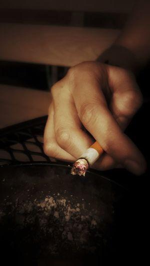 Human Hand Close-up Smoking Cigarette Butt Cigarette