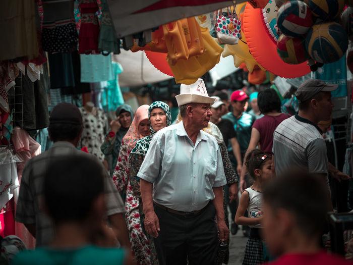 Market day in Jayma Bazaar in Osh, Kyrzgystan Bazaar EyeEmNewHere Kyrgyzstan Osh City Crowd Group Of People Lifestyles Market Men People Real People Retail Display Street Streetphotography Women The Photojournalist - 2018 EyeEm Awards The Traveler - 2018 EyeEm Awards The Street Photographer - 2018 EyeEm Awards