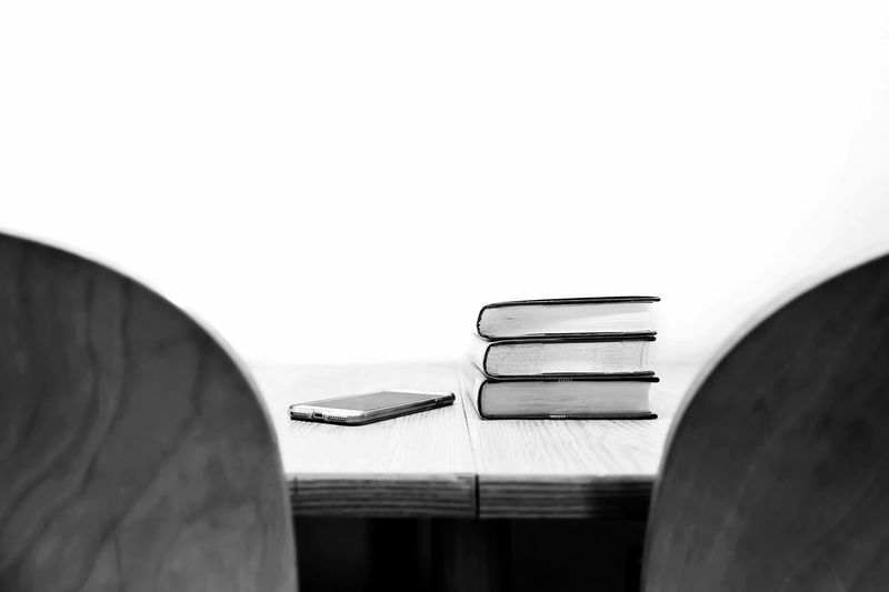 Black And White White Background White Wall Learning Learn Study Time Study Technology Everywhere Technology Book Books Books To Read Reading Books Reading Studying Lifestyle The Still Life Photographer - 2018 EyeEm Awards Copy Space Indoors  Close-up Built Structure Wall - Building Feature Still Life Table
