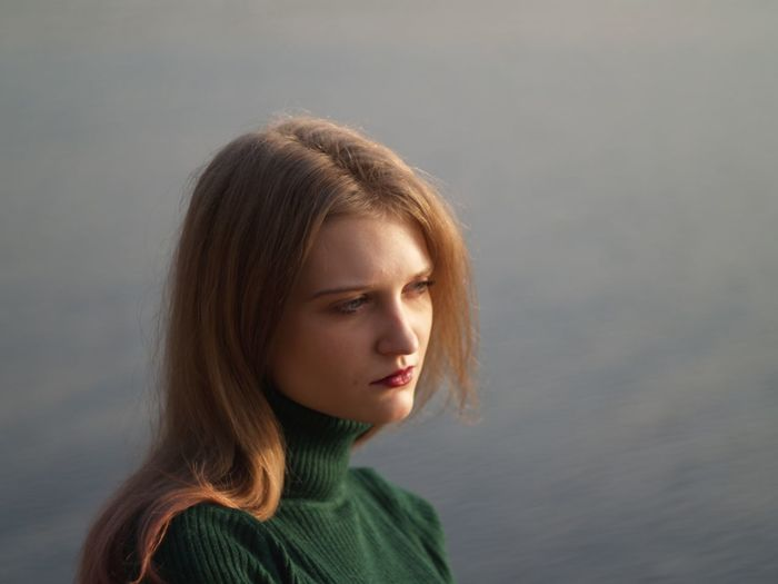 Close-Up Of Beautiful Young Woman Looking Away