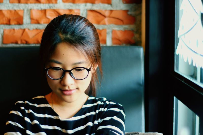 EyeEm Selects Eyeglasses  Young Adult Teenager Indoors  Lifestyles Casual Clothing Portrait Day Cute♡ Smile Freshness Brick Wall Woman Girl Asian
