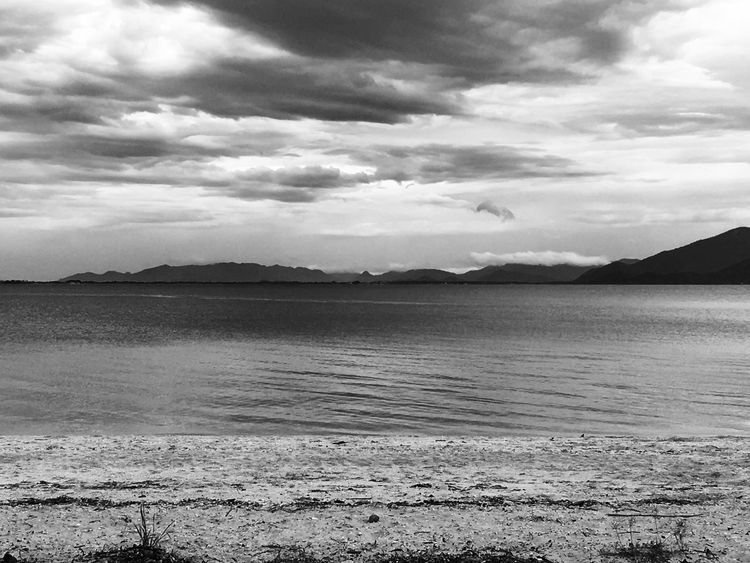 Atmospheric Mood Beach Cloud Cloudy Coastline Distant Horizon Over Water Light Outdoors Remote Sand Scenics Sea Seascape Shore Sky Tranquil Scene Tranquility Water