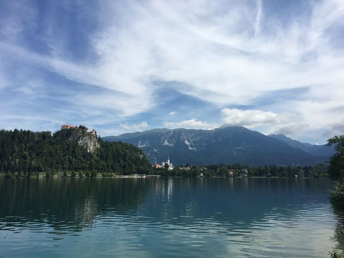 Scenic view of lake bled and mountain against sky