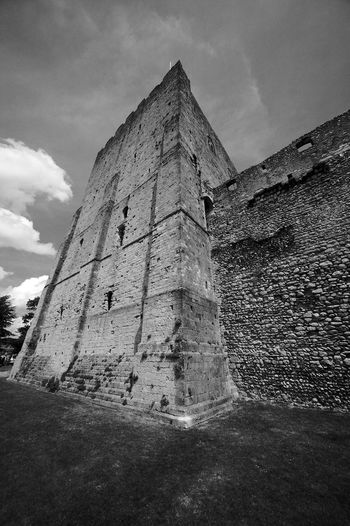 Outside The Tower Ancient Architecture Blackandwhite Building Building Exterior Built Structure Cloud - Sky Fort History Low Angle View Old Outdoors Ruined Sky Stone Wall The Past Tower Wall