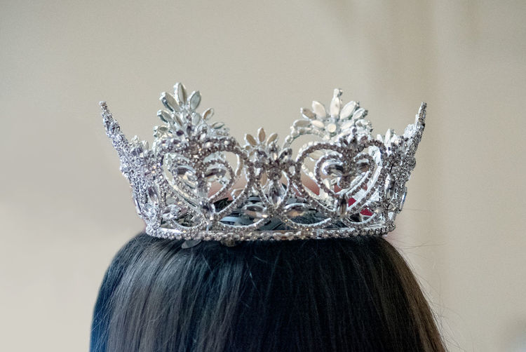 Close-up of woman wearing crown