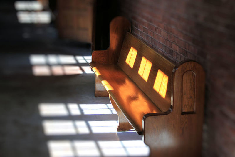Bench Architecture Brick Wall Illuminated Low Angle View No People Peaceful Selective Focus Sunlight And Shadow Warm Light