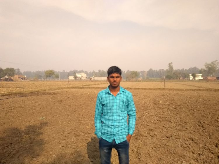 EyeEm Selects Front View One Man Only Adult One Person Only Men Standing Portrait Adults Only People Looking At Camera Day Young Adult Outdoors Rural Scene Men Sky Nature