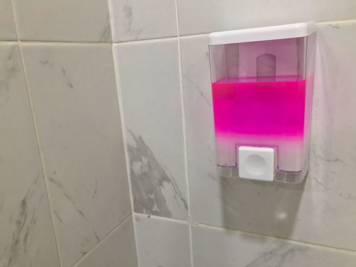 Pink Color Tile Wall - Building Feature No People Indoors  Flooring Close-up Architecture Multi Colored White Color Built Structure Paper Domestic Room Bathroom Paint Plastic Hygiene Container Creativity Security