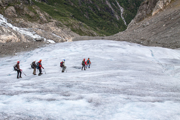 Adventure Beauty In Nature Cold Day Enjoyment Glacier Glacier Walk Group Of People Ice Landscape Mountain Mountain Range Nature Norway Outdoors Recreational Pursuit Remote Scenics Landscapes With WhiteWall Tranquility Ice Age Waterfall Folgefonna Buarbreen Q wie queue