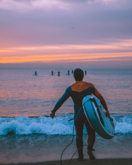 Surfing during the sunrise in Barcelona Barcelona Be Brave SPAIN Beach Beachphotography Beauty In Nature Full Length Horizon Horizon Over Water Land Leisure Activity Lifestyles Men Motion Real People Rear View Scenics - Nature Sea Sky Standing Summer Sunset Surfing Water Wave