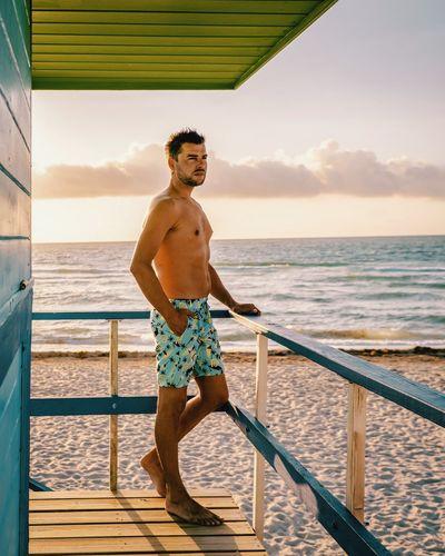 Miami Miami Beach Miami South Beach Men Man Beach Boy Boy Men Protrait Boys Beach Life Lifeguard  Sunset Sunrise Water Sea Full Length Beach Standing Shirtless Summer Healthy Lifestyle Sport Smiling Orange Color Lifeguard Hut Lookout Tower Wave Surf Shore Horizon Over Water