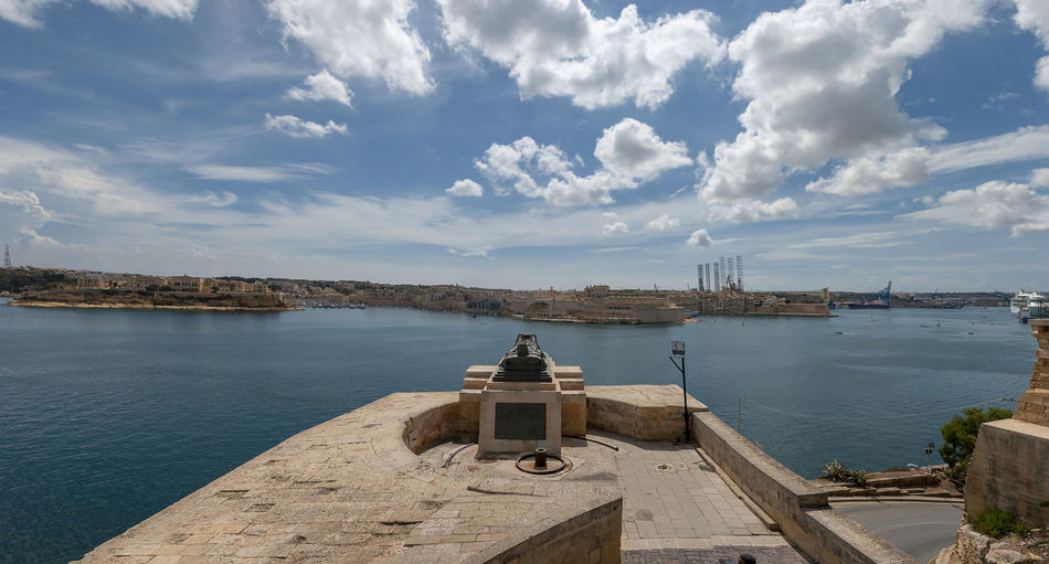 The War Siege Memorial overlooking Valletta Harbour in Malta City Cityscape Harbor Harbour Malta Sky And Clouds War Memorial Architecture Building Exterior Built Structure Cloud - Sky Day Landscape No People Outdoors Sky Summer Travel Destinations Valletta Valley World War II